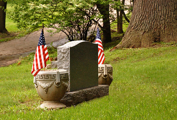 tombstone with flags stock photo