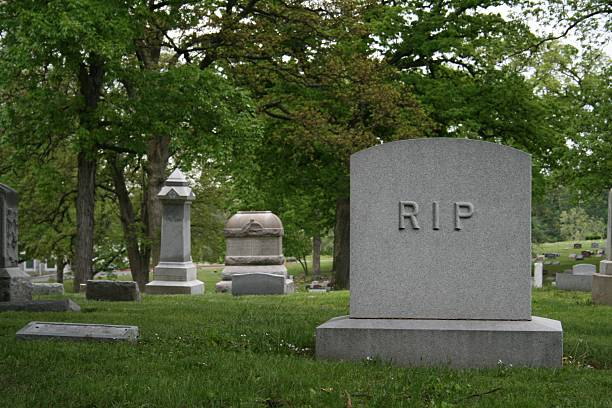 Tombstone with RIP stock photo