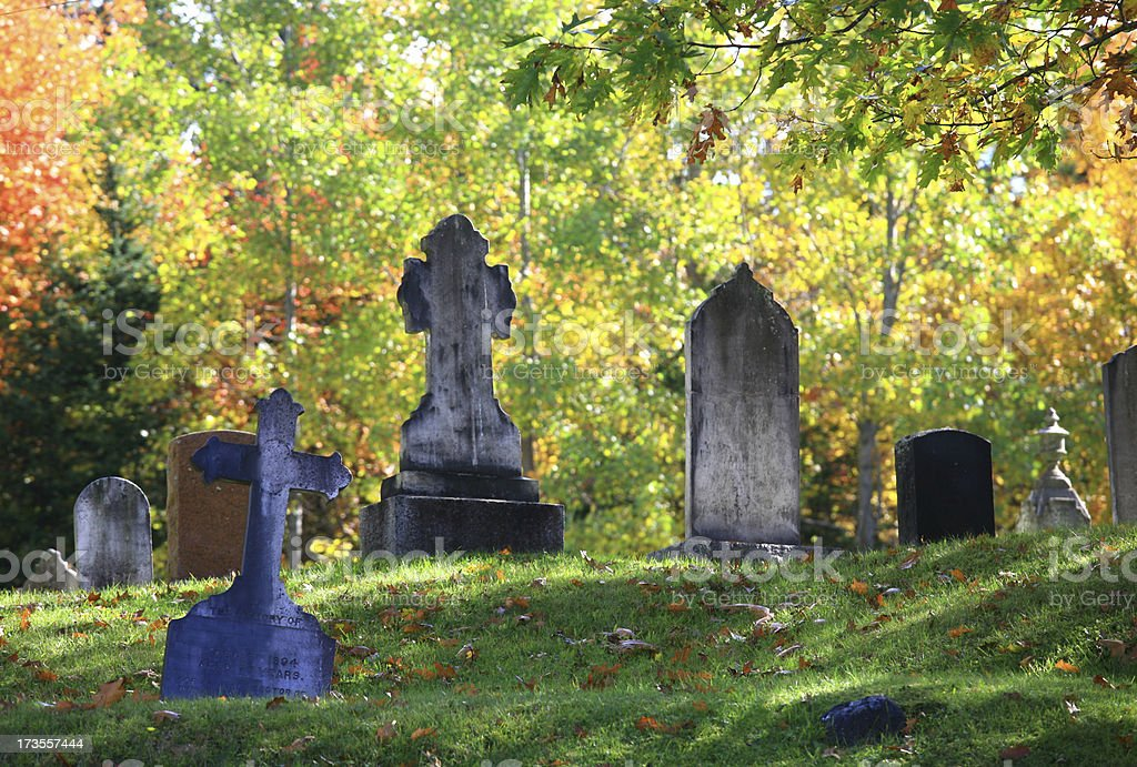 Tombstones at Graveyard in Fall royalty-free stock photo