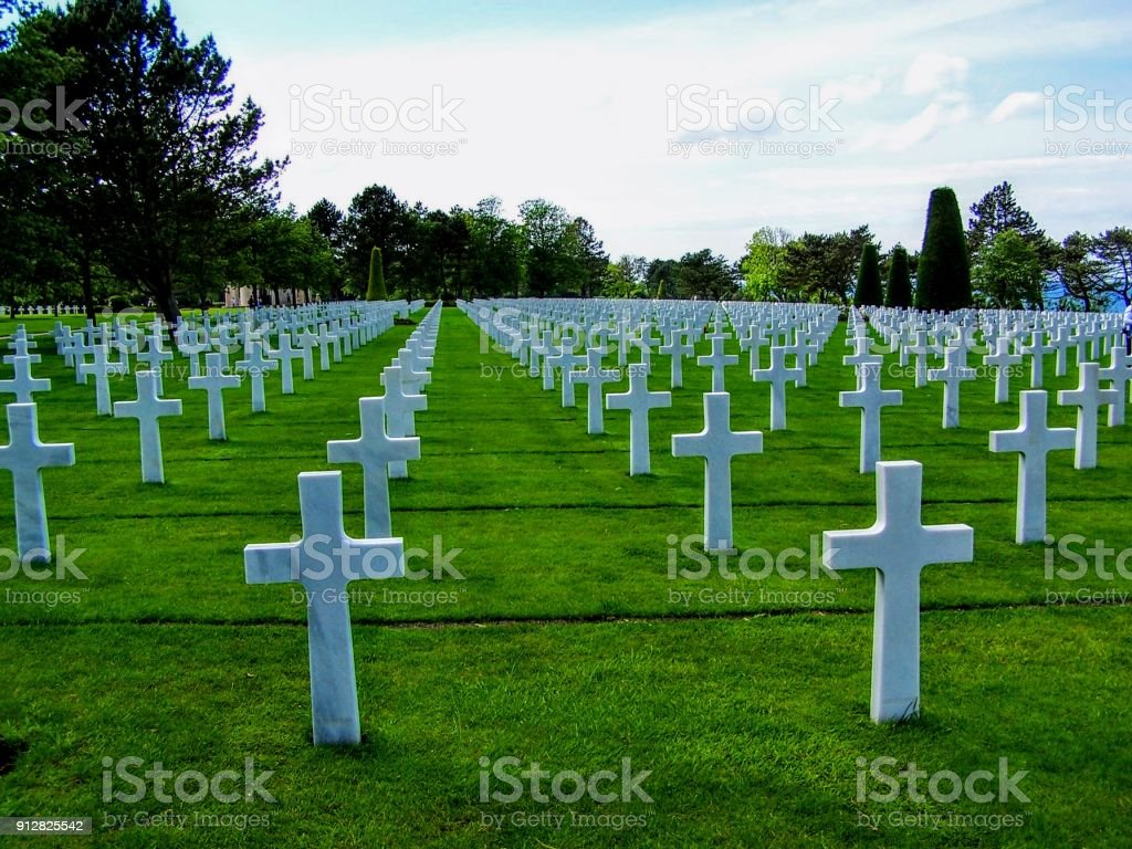 COLLEVILLE-SUR-MER FRANCE: Tombstones at the Normandy American Cemetery and Memorial in Colleville-Sur-Mer France stock photo