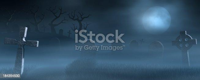 A foggy graveyard at full moon.