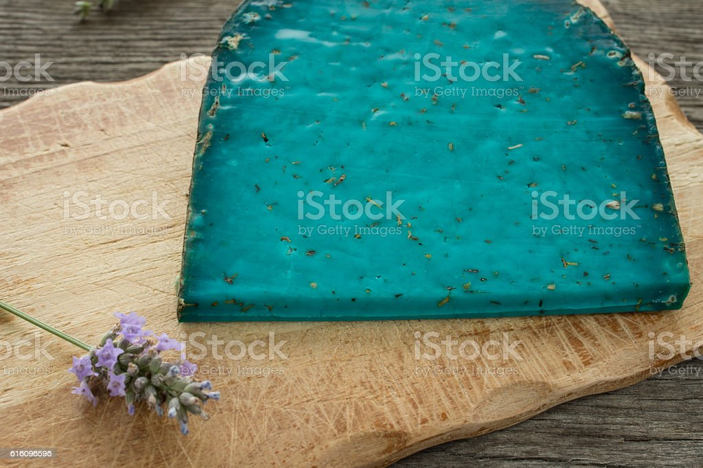 Tomme du Berry blue cheese of raw milk stock photo