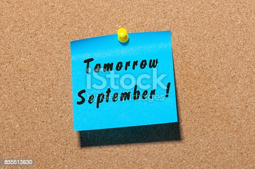 istock Tomorrow September. hand drawn lettering on color sticker pinned to notice corl board background 835513630