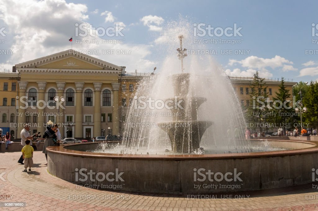 Tomsk, Russia,The Tomsk University of Control Systems and Radioelectronics in summer day. July 10, 2017. Lot of peoples around. Big fountain stock photo