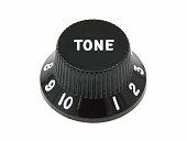 A tone control knob from a Fender bass guitar