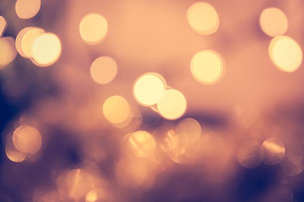 toned bokeh with blinking christmas lights in vintage style - luz da vela - fotografias e filmes do acervo