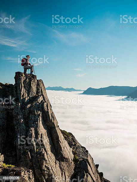 Photo of Toned image of an adult woman standing on top mountain