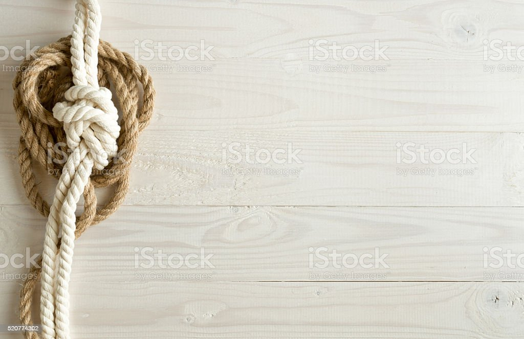 Toned image of ship ropes on wooden background stock photo