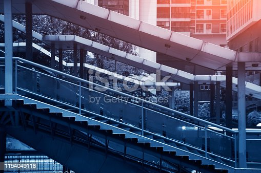 istock Toned image.Side view of the staircases in Guangzhou. 1154049118