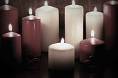 red and white candles with bright fire flame