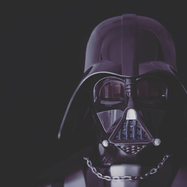 toned portrait of darth vader mask and helmet - fantasie disney stock-fotos und bilder