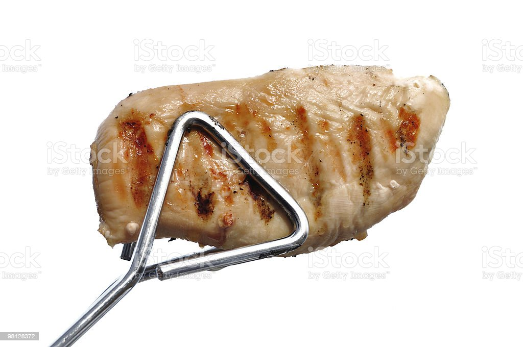 Tongs Holding a Grilled Chicken Breast royalty-free stock photo