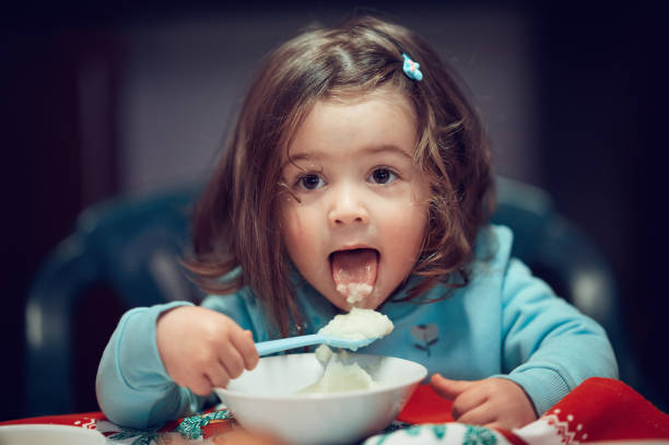 Tongue out while eating! stock photo