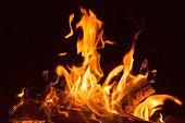 Flaming bonfire and embers.