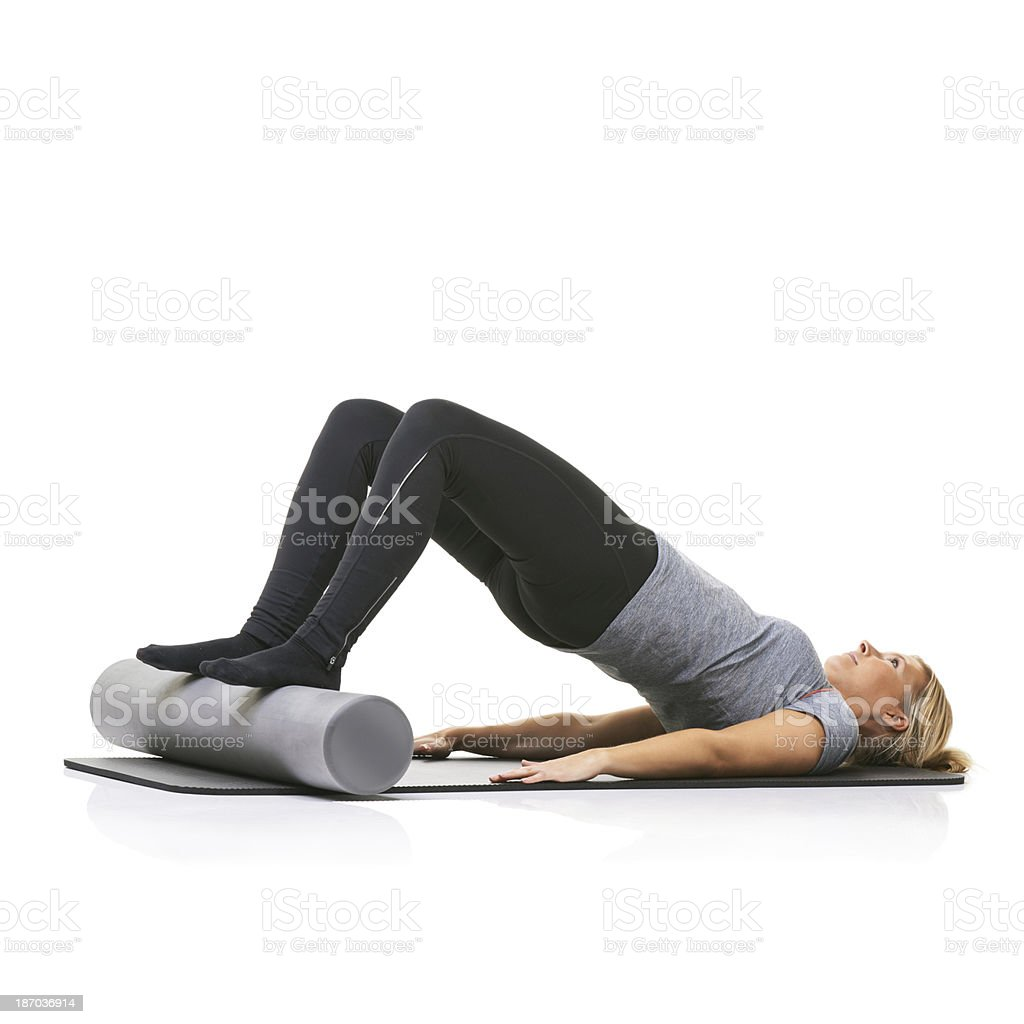 Toning and strengthening her muscles royalty-free stock photo