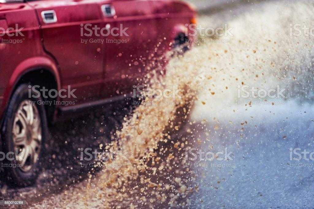 toning car rain puddle splashing water stock photo