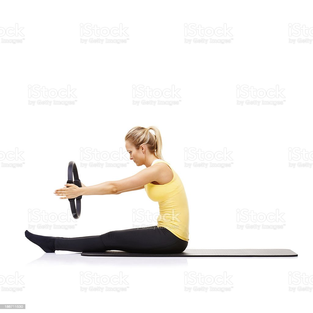 Toning her core muscles royalty-free stock photo