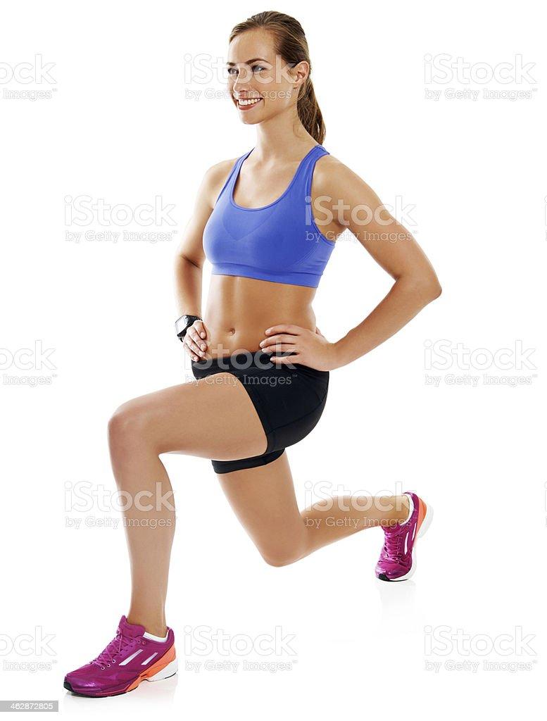 Toning her quads stock photo