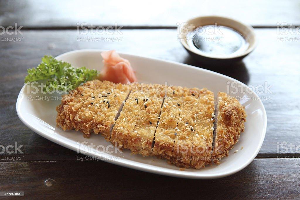 Tonkatsu pork cutlet on wooden table royalty-free stock photo