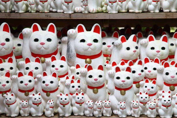 Tons of small dolls the beckoning cat known as maneki neko at in picture id857852966?b=1&k=6&m=857852966&s=612x612&w=0&h=3d1xaza91xnqzrci3l8jrp7oxmrktf5xxevefzcp5ag=