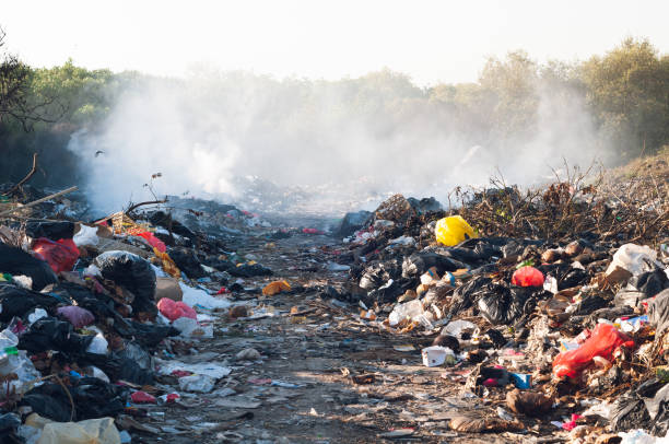 Tons of waste in Indonesia on a garbage dump in nature Tons of waste in Indonesia on a garbage dump in nature Tons of waste in Indonesia on a garbage dump in nature stock photo