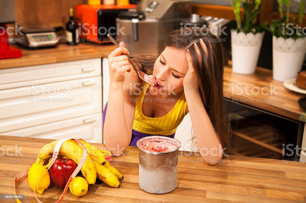 Too depressed for dieting. stock photo