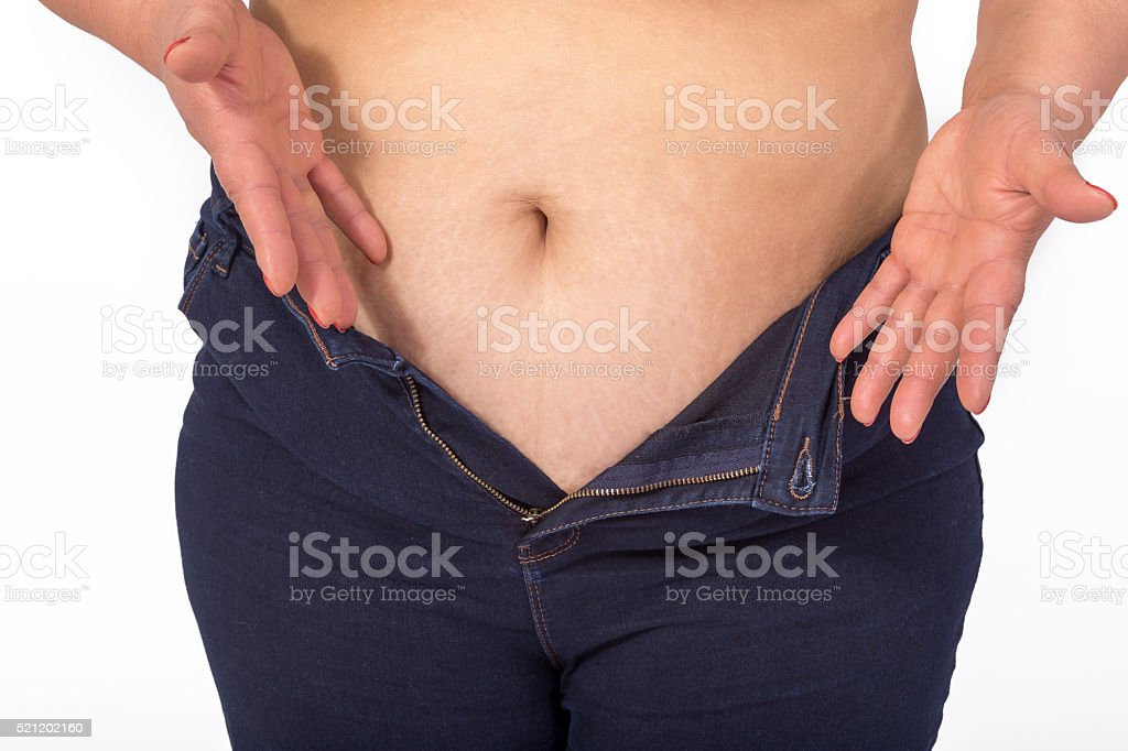 Too fat for fit jeans stock photo