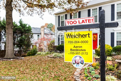 istock Too late real estate home buyer sign in front of house in Fairfax County, Virginia neighborhood with realtor name number, Weichert 913066164
