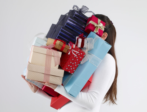 Woman carrying gift boxes.