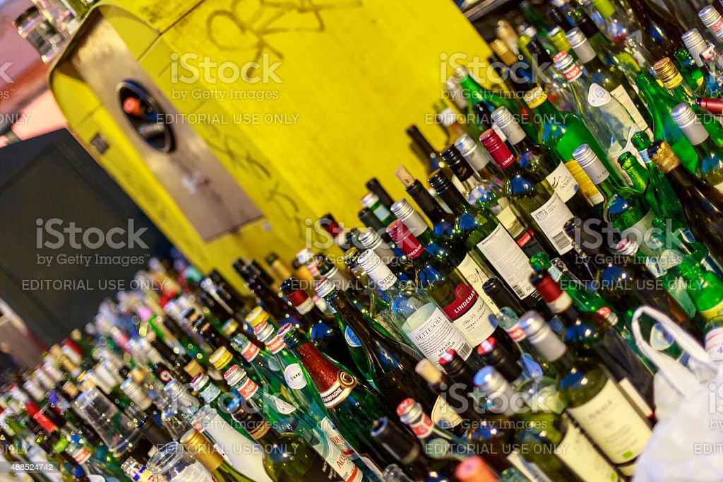 Too much bottles for recycling container. stock photo