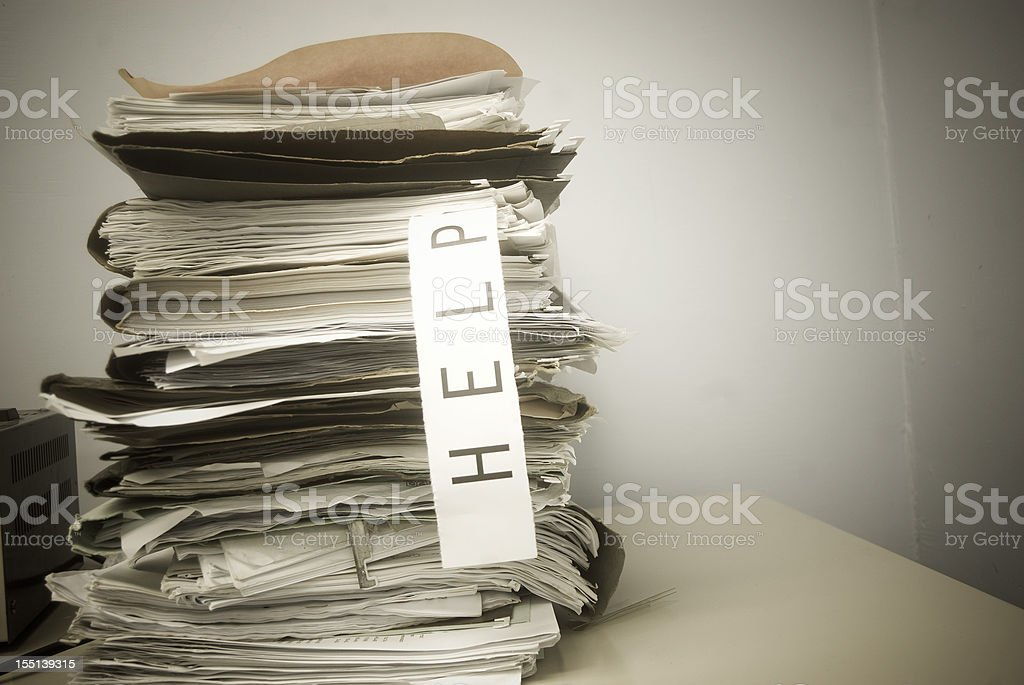 HELP; too much paperwork royalty-free stock photo