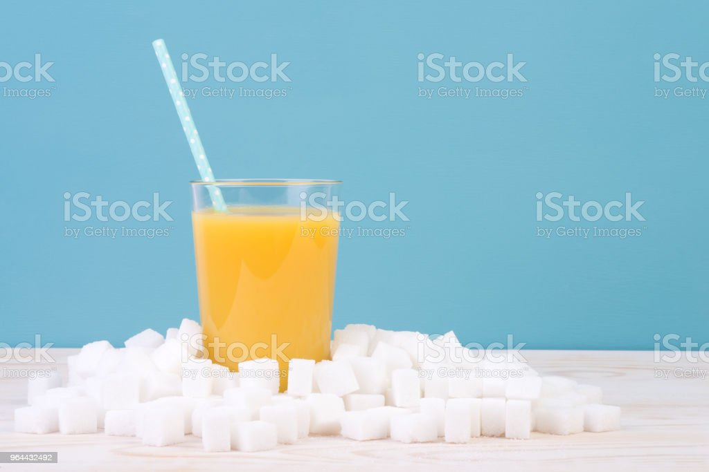 Too much sugar in juice concept - Royalty-free Blue Stock Photo