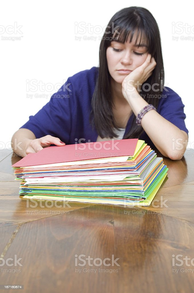 Too much to do, young woman with stack of paperwork royalty-free stock photo