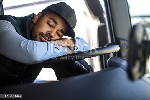 Truck driver sleeping. About 35 years old, African male.