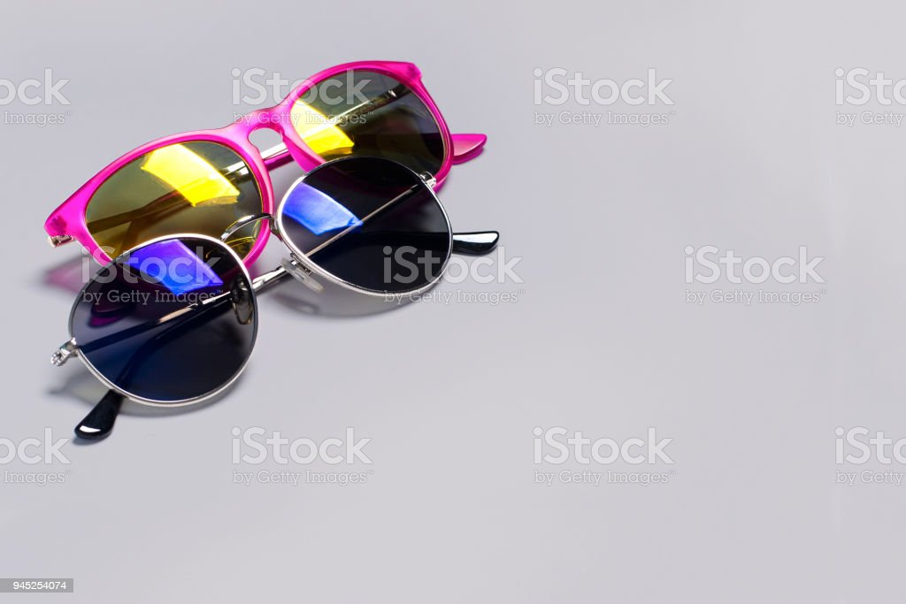 Too stylish fashionable sunglasses isolated on a grey background. The concept of stylish poster, banner stock photo