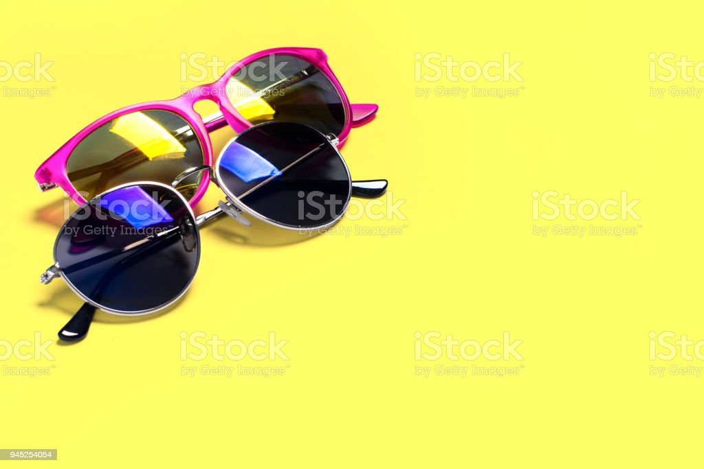 Too stylish fashionable sunglasses isolated on a yellow background. The concept of stylish poster, banner stock photo