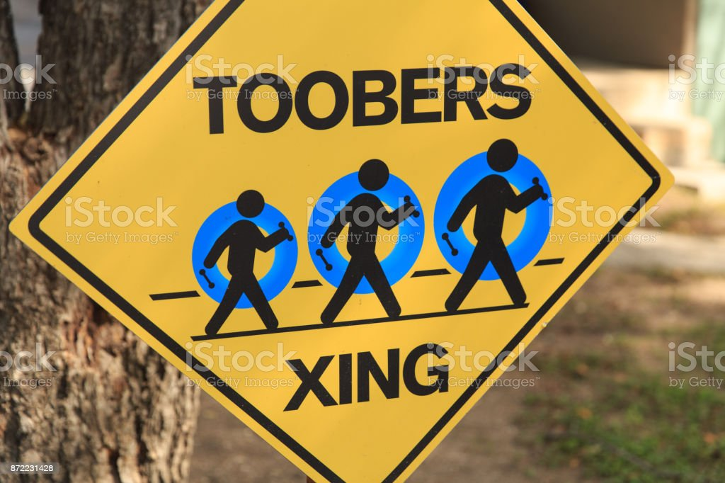 Toobers Xing sign for people floating in the river. stock photo