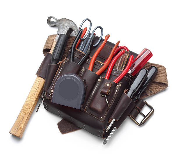 tool belt full of tools isolated on white background - tool belt stock photos and pictures
