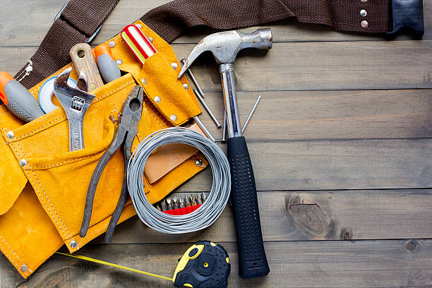 tool belt stuffed with various tools - tool belt stock photos and pictures