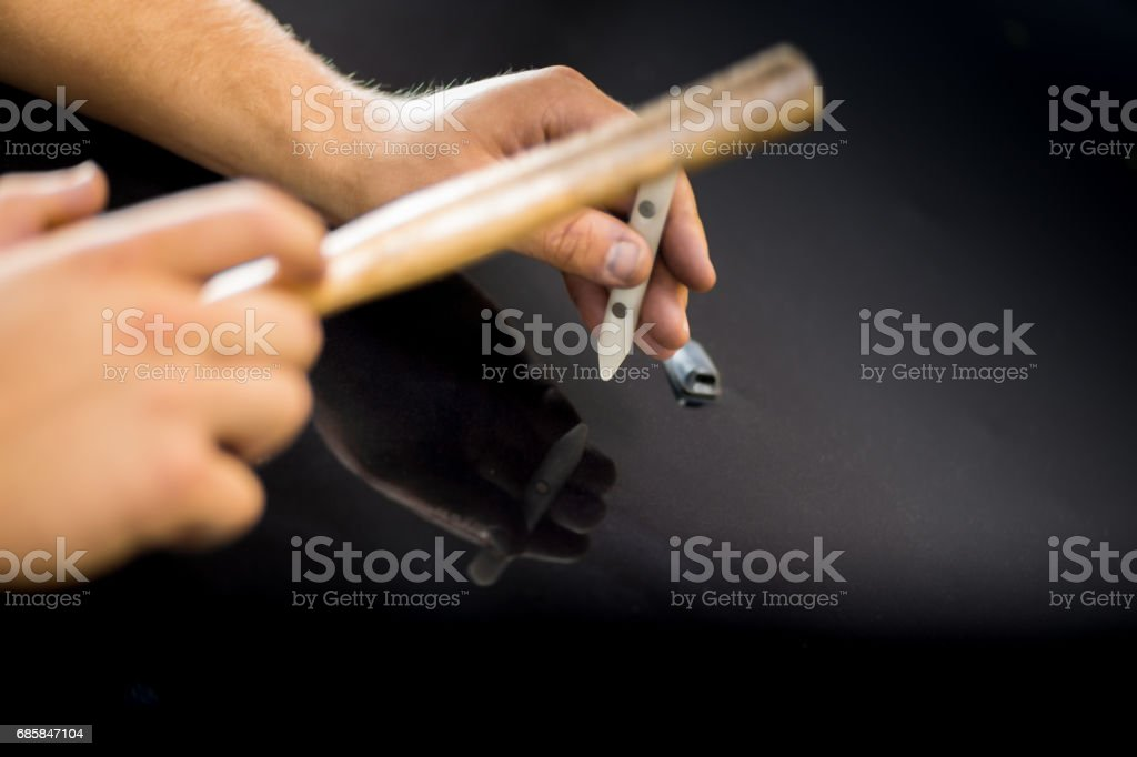 Tool for repairing dents in the car stock photo