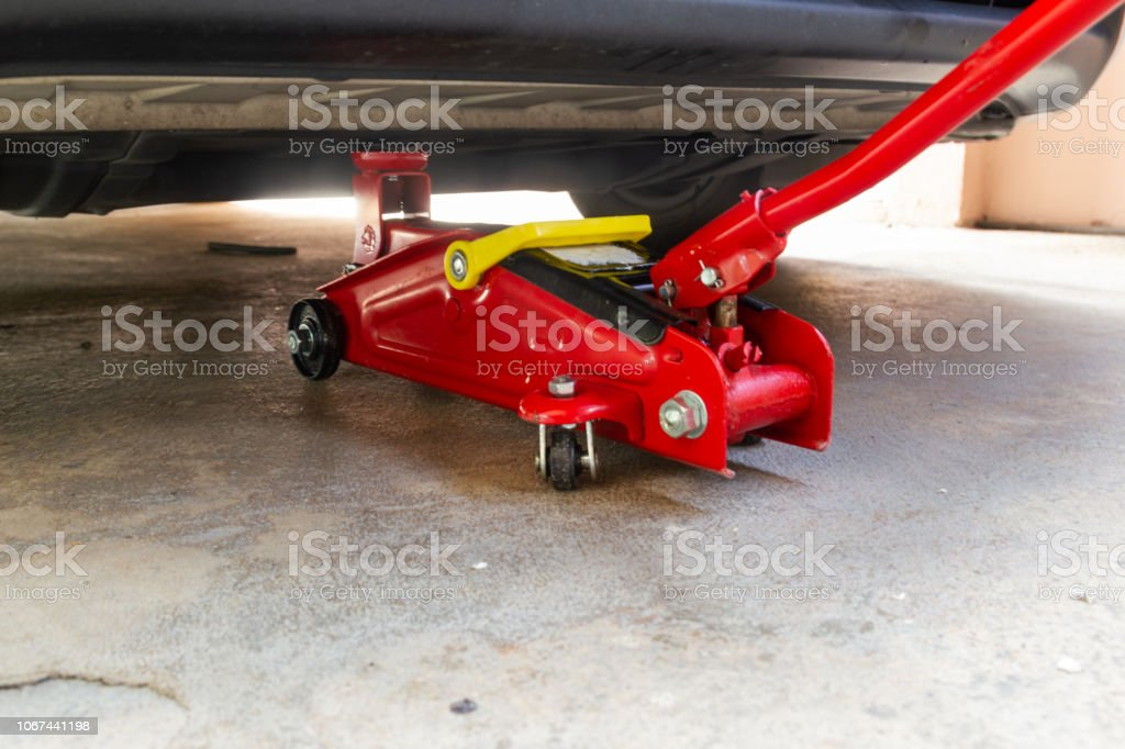 Royalty Free Car Jack Pictures Images And Stock Photos Istock