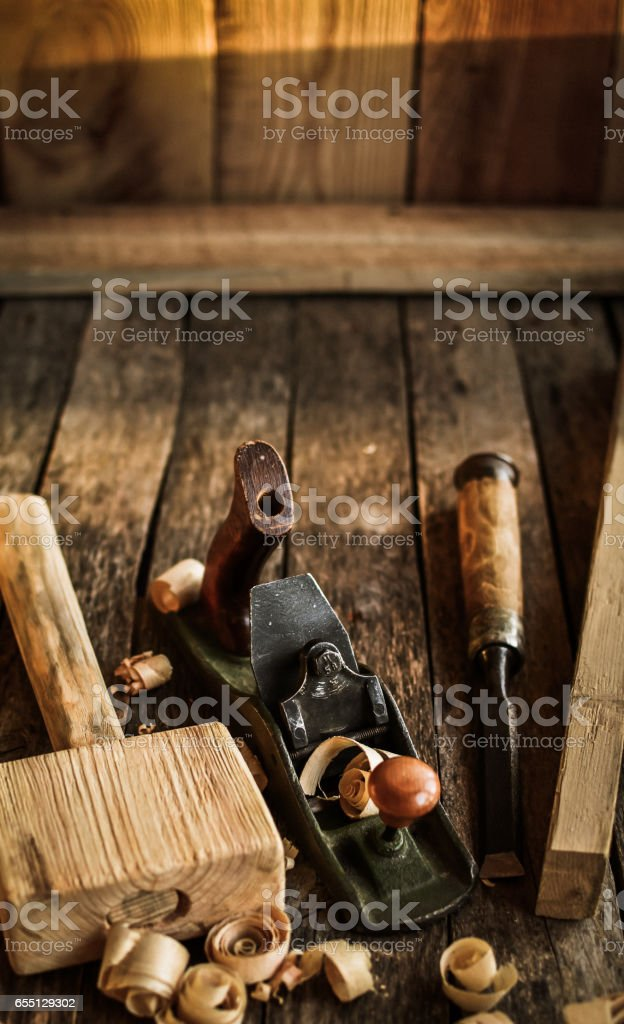 Old carpenter tools on a dilapidated bench