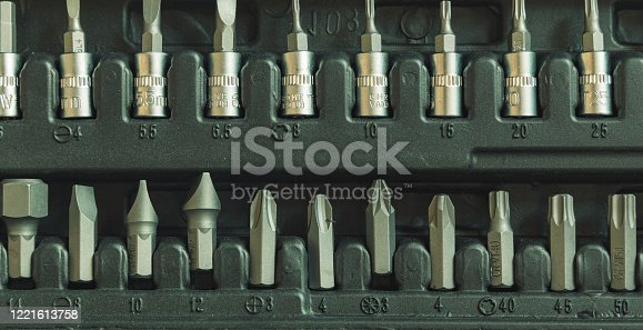 tool kit working screwdriver head in box cells industrial background objects