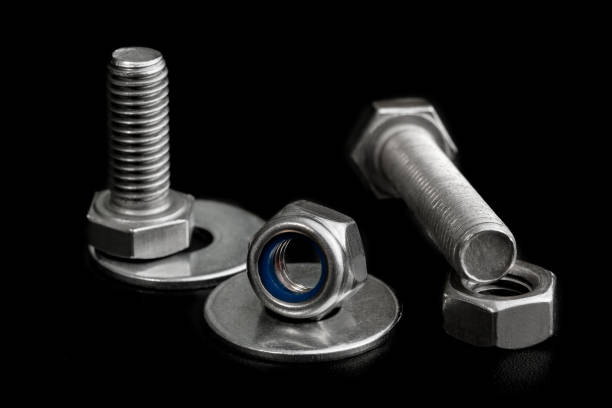 Tool Set Of Iron Screws And Nuts. Closeup on black background Tool Set Of Iron Screws And Nuts. Closeup on black background washer fastener stock pictures, royalty-free photos & images
