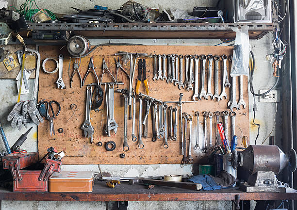 Tool shelf against a wall Old tools hanging on wall in workshop , Tool shelf against a wall workbench stock pictures, royalty-free photos & images