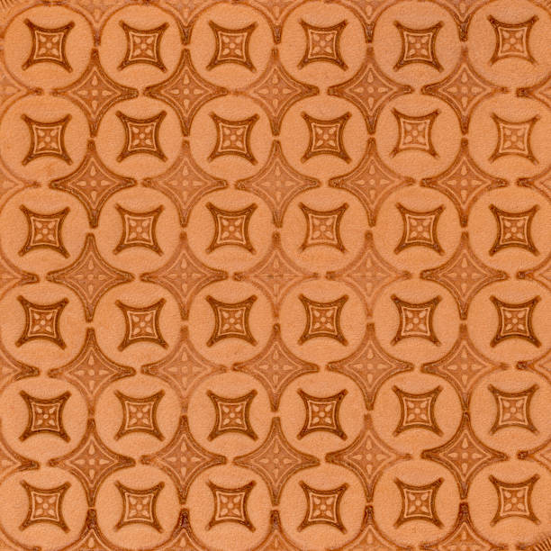 tooled leather in diamond diaper pattern stock photo