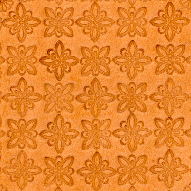 tooled leather in floral diaper pattern stock photo