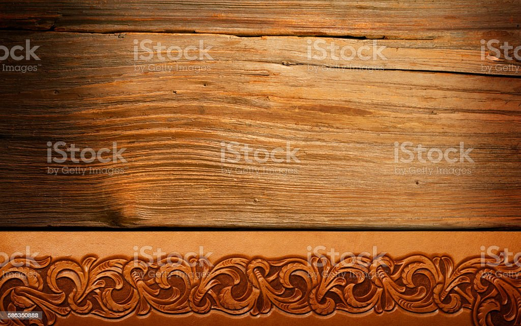 Tooled Leather On Old Fence Wood stock photo