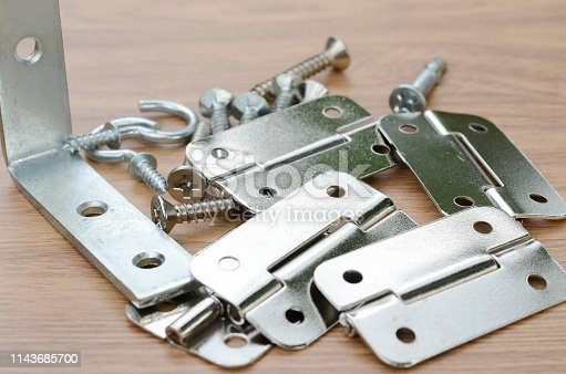 1143685700istockphoto Tools and auto spare parts on a wooden work  bench surface. 1143685700