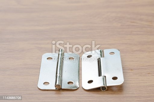 1143685700istockphoto Tools and auto spare parts on a wooden work  bench surface. 1143685705